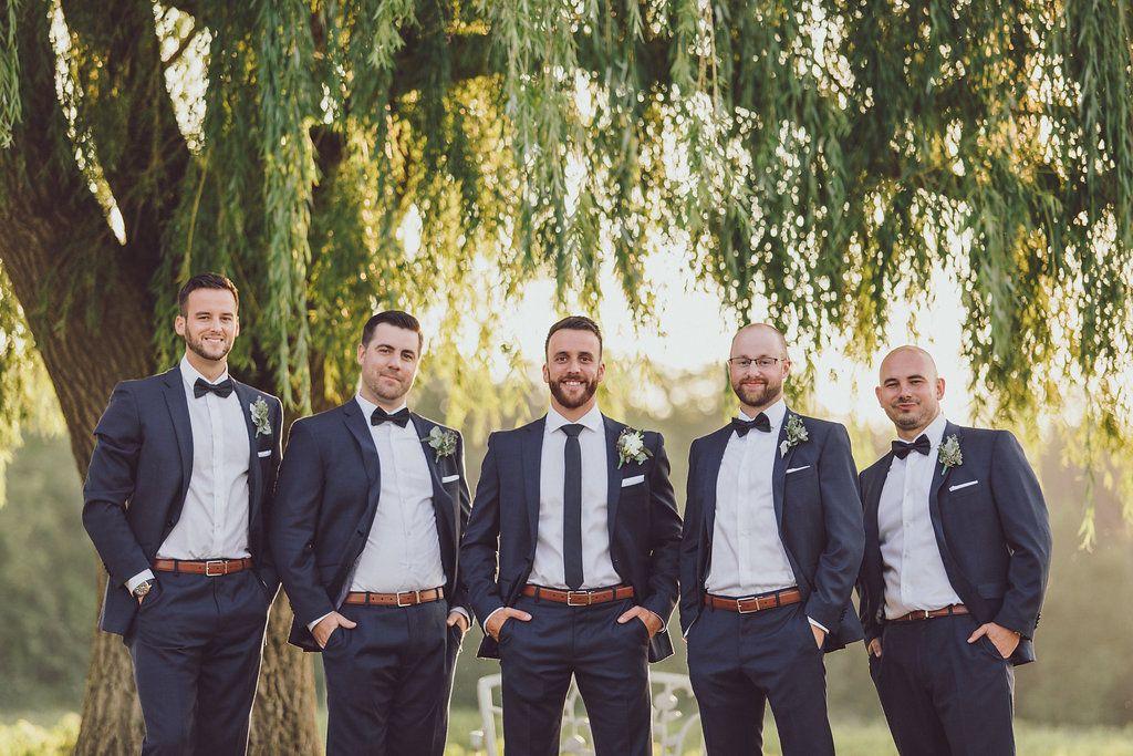 Groomsmen posing in Navy suits