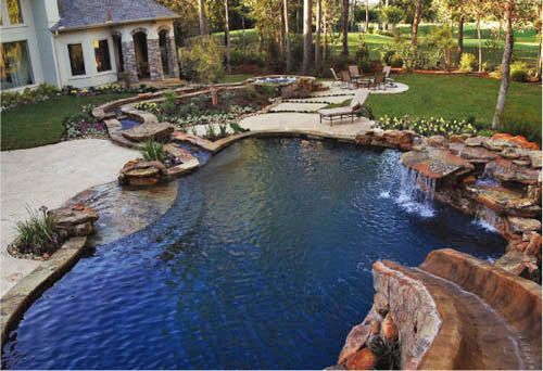 Pool Designs With Waterfalls And Slides natural stone scape pool with beach entry, slide and rock ledge
