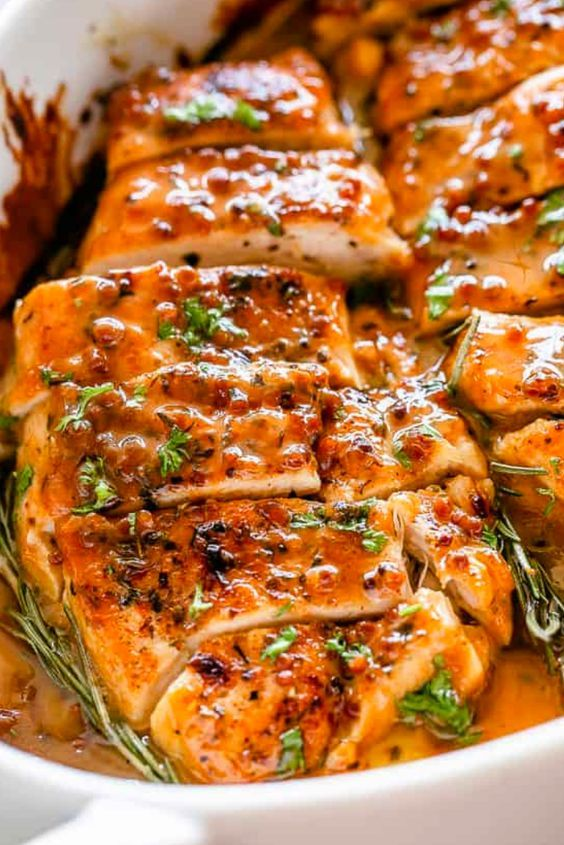 Savory, juicy Baked Honey Mustard Chicken bakéd in a zésty saucé! Pérféct for sérving with your favorité véggiés ovér noodlés or ricé. #chickenrecipes #dinner #bakedchicken #mustardchicken #recipes #dinnerrecipes #chickenrecipe #chickentender #chickenfoodrecipes #easyrecipe #recipeoftheday #popularrecipe #foodrecipe #maincourse #familyrecipe #easterrecipe | baked chicken breastrecipes easy | baked chicken breastrecipes | baked chicken tender recipes | baked chicken recipes healthy ovens | #chickenbreastrecipeseasy