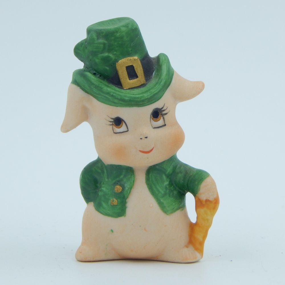 SOLD - Vintage pre-owned matte bisque decorative collectible porcelain ceramic pig figurine.  The pig is dressed in a green top hat with a shamrock and an open green coat.  One hand is on a walking cane and one hand is on one hip. #Vintage #Lefton #Pig