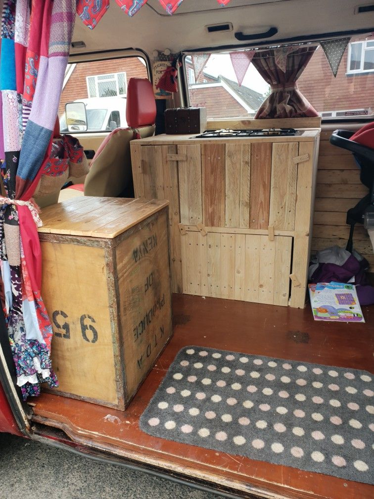 Custom home built campervan storage units and kitchen in our