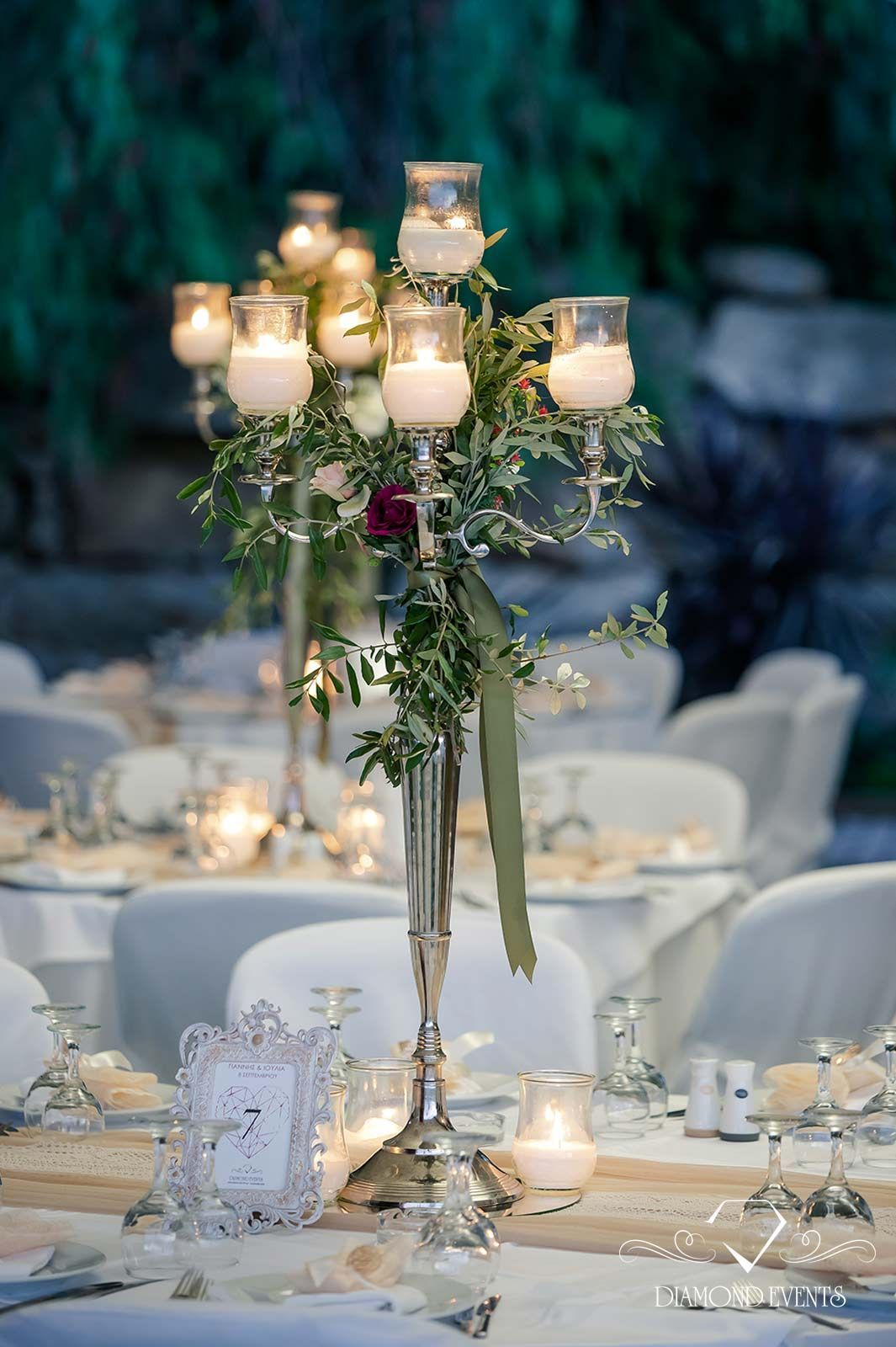 Rustic wedding table decor with olive leaf, garland, roses