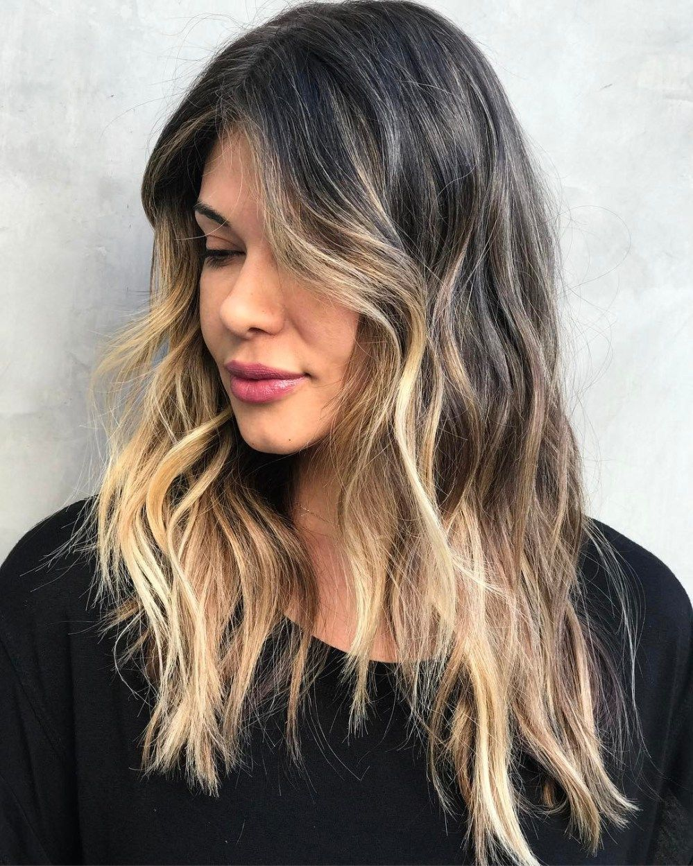 10 Super Chic Hairstyles for Long Faces to Break Up the Length