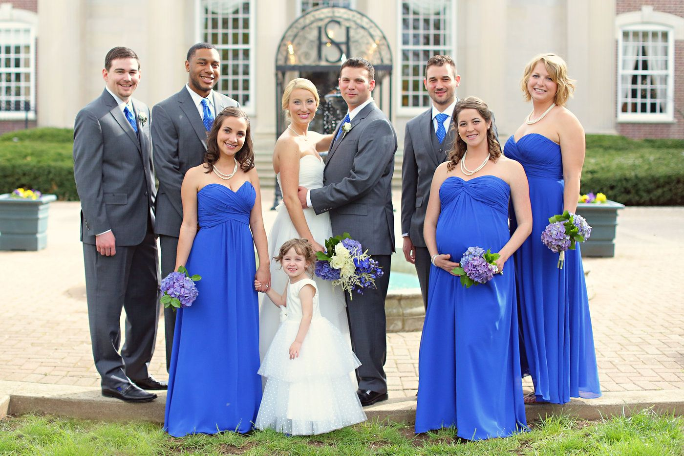 Wedding party royal blue bridesmaids and ties with grey suits