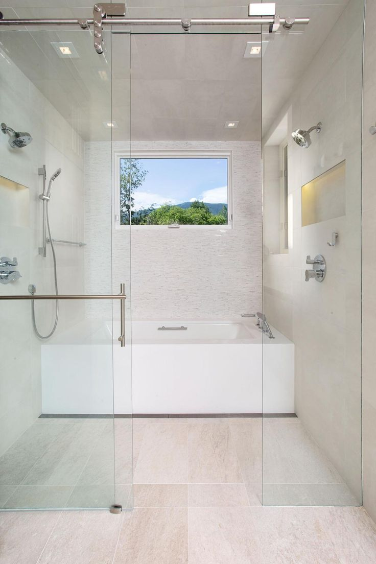This Contemporary Bathroom Incorporates A Wet Room Area With No Threshold Shower And Separate Soaking Tub Large Window Allows Natural Light To