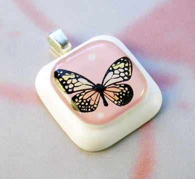 This simple, sweet and delighful butterfly pendant seems to smile at you :)