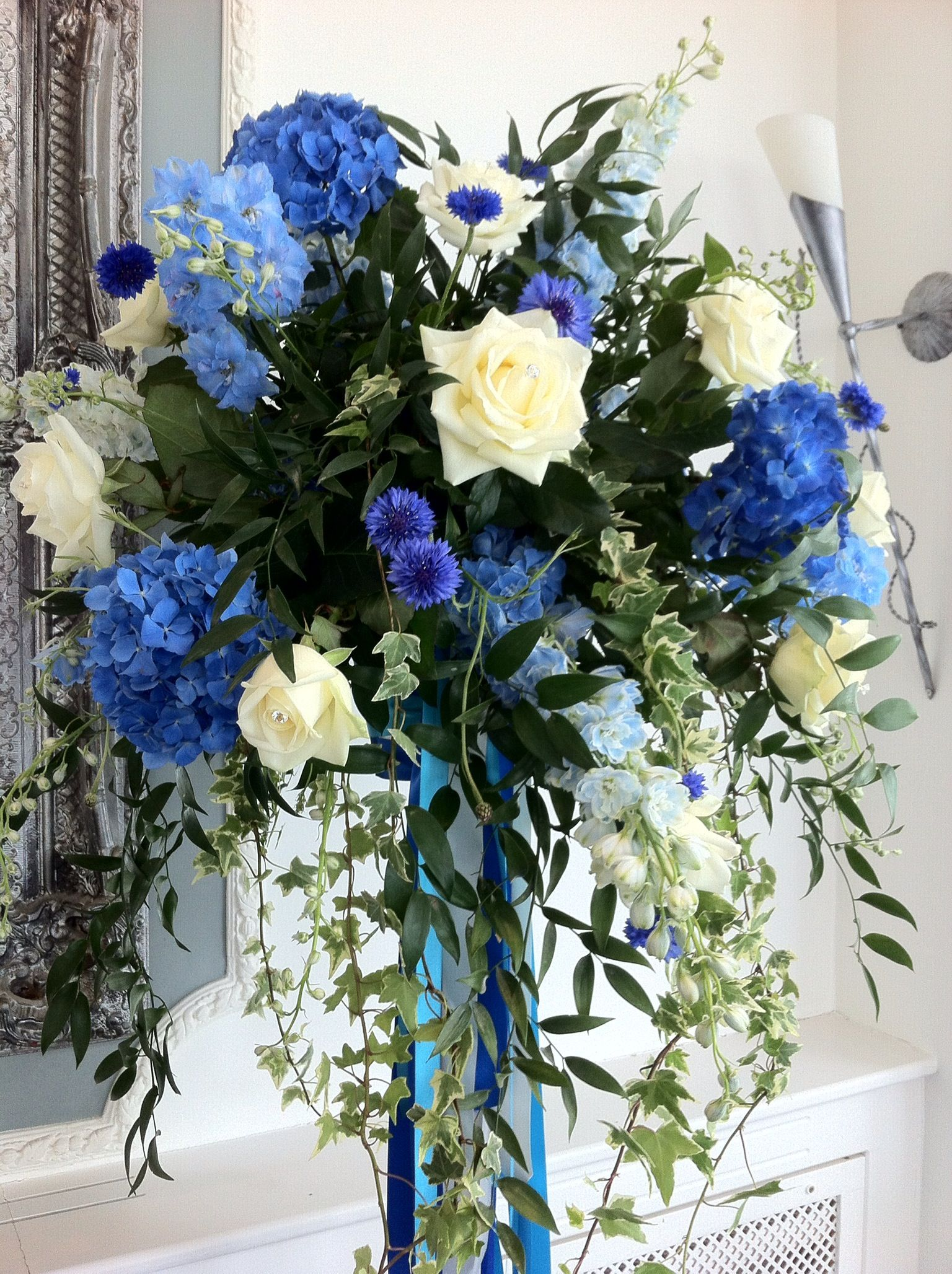 Flower ball pedestal of blue Delphiniums, Roses