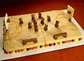 Make the REESE'S Basketball Court Cake recipe from REESE'S and please the crowd at your next college football party or tailgate!