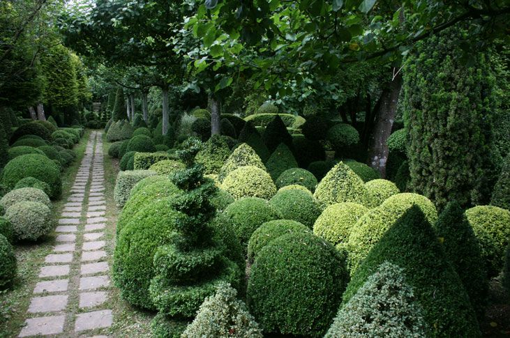 The topiary garden is made up of more than 400 different shapes of box and yew --Les Jardins de Séricourt in Séricourt, France