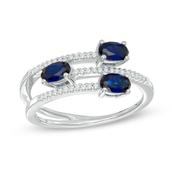 Oval Blue Sapphire And 1 10 Ct T W Diamond Three Stone Wrap Ring In 10k White Gold White Gold Fashion Rings Stone Wrapping