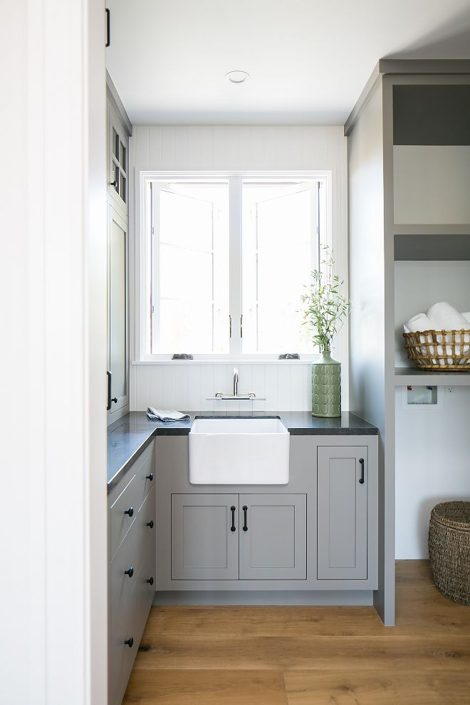 Grey laundry room with small farmhouse sink This grey ...