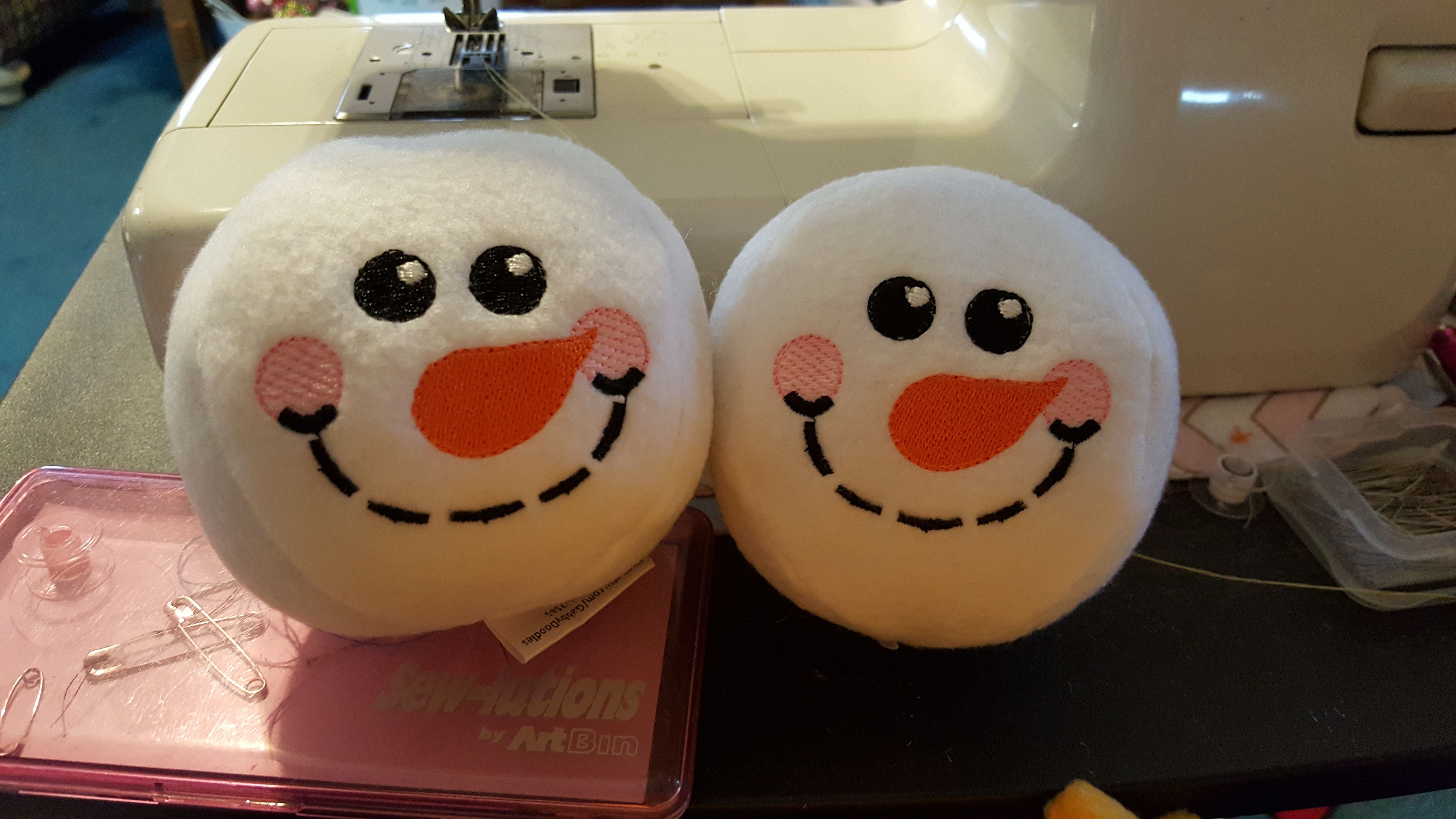 """Who doesn't love a snowball fight.  With these fleece snowballs you can """"fight"""" whenever you want!! Check out all my handmade and embroidered items on my FB page.  www.facebook.com/GabbyDoodles"""