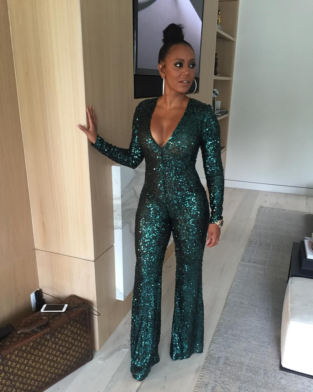 e7fb941099f Sparkly Sequined Hunter Green Jumpsuit  Instagram photo by Mel B • Apr 10