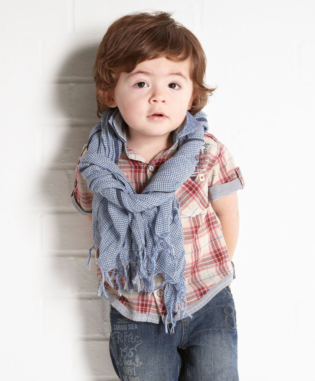 The perfect way to make his outfit even more adorable is to throw on a stylish dress shirt for toddler boys and babies available from The Children's Place.