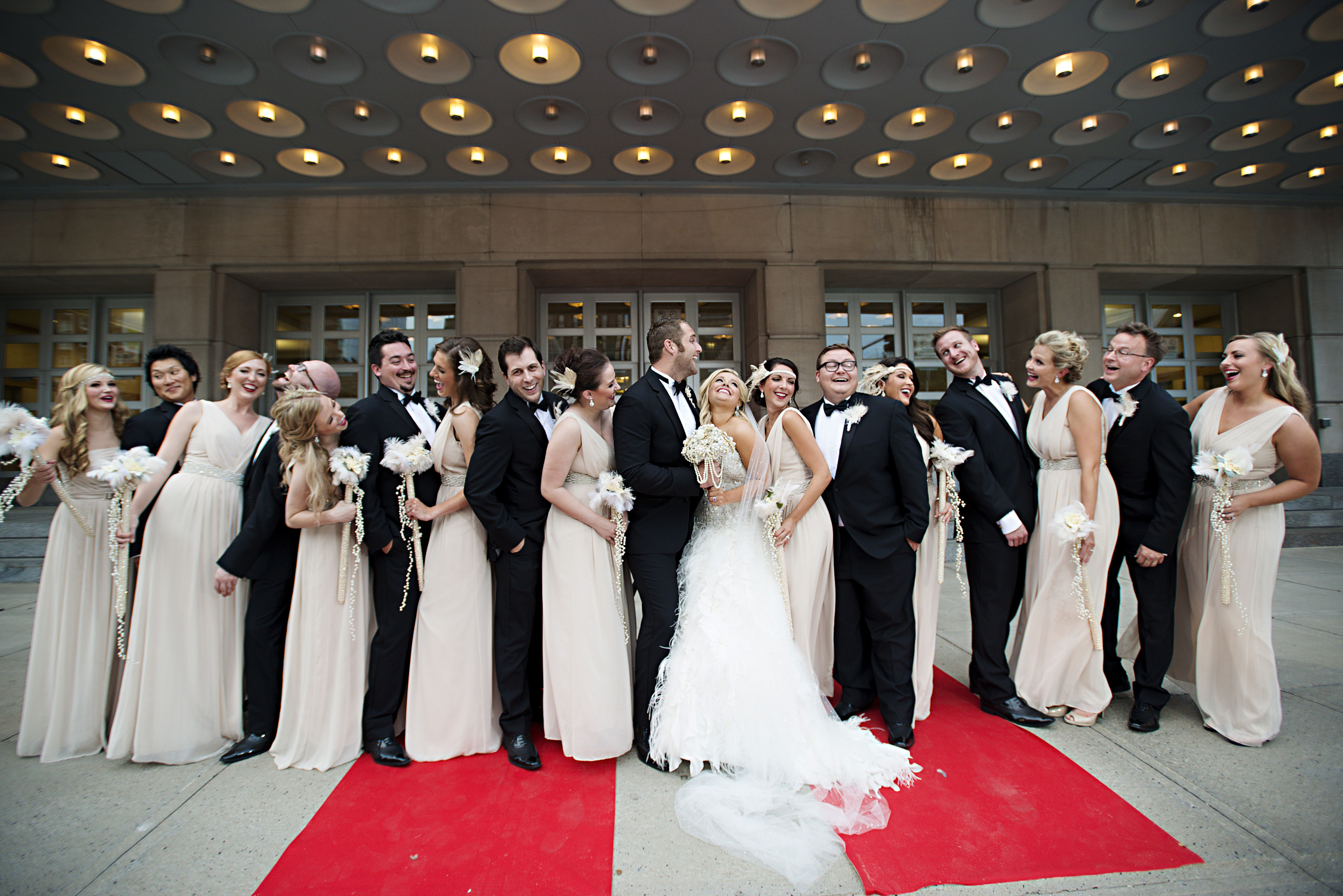 Formal champagne bridesmaid dresses and black groomsmen tuxedos