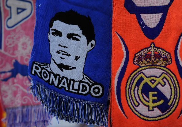 A scarf shows an image of Real Madrid CF player Cristiano Ronaldo at a merchandise stall prior to the La Liga match between Real Madrid CF and FC Barcelona at estadio Santiago Bernabeu on March 23, 2014 in Madrid, Spain.