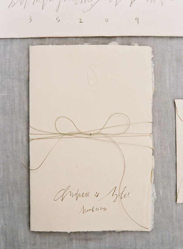 handmade-paper-deckled-edge-rough-ivory-pencil-hand-lettering-wedding-invitation-bow-twine