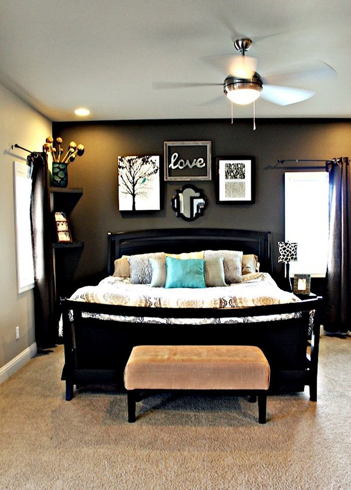 Master bedroom with dark grey accent wall light grey walls dark