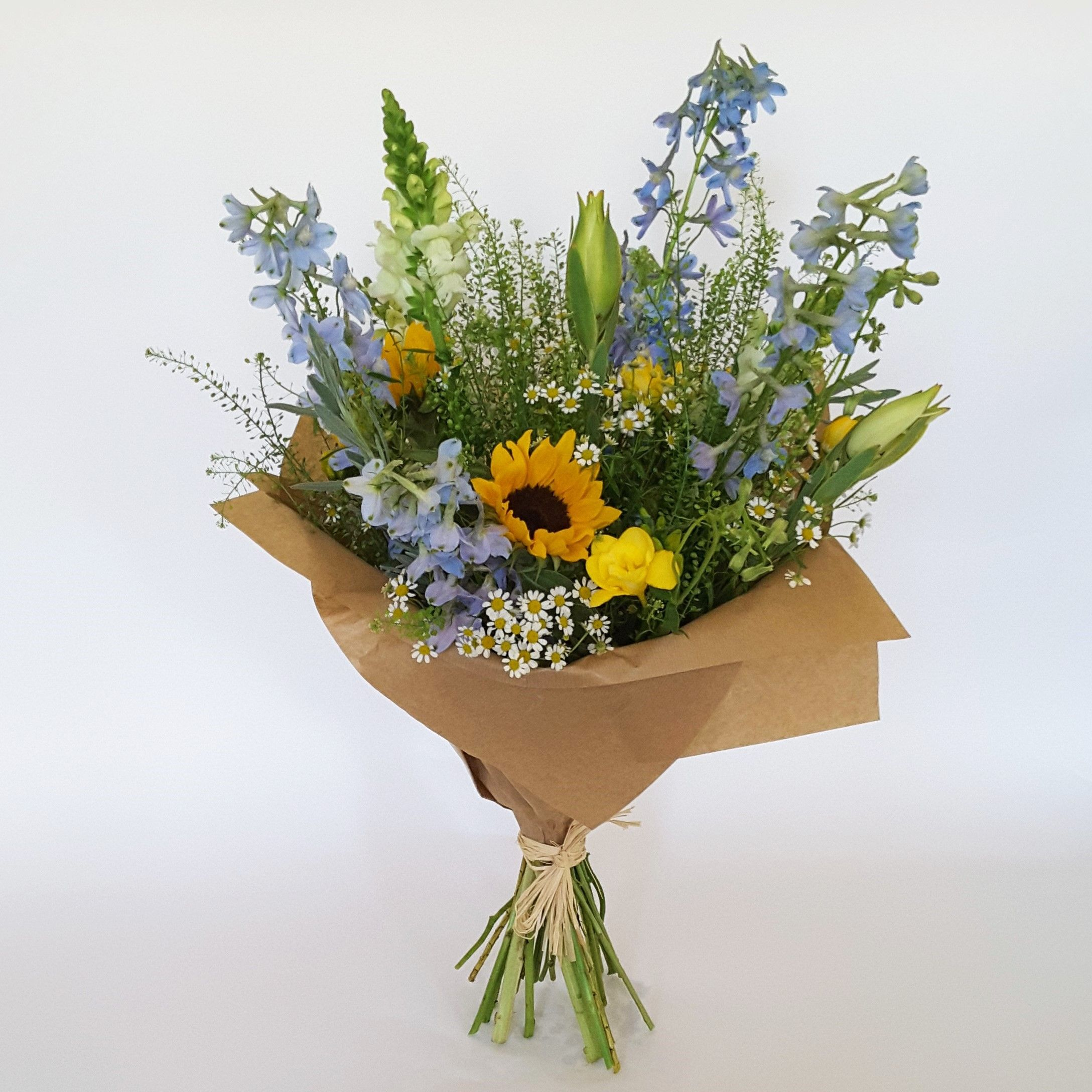 A Bright Handtied Bouquet Of Light Blue And Yellow Flowers