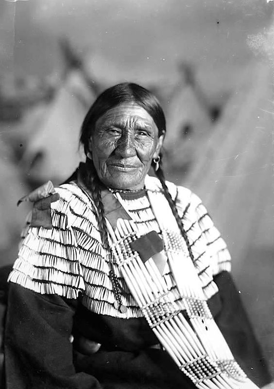 Bear Face Woman. Sioux. Early 1900s. Photo by F.B. Fiske. Source - State Historical Society of Nebraska.