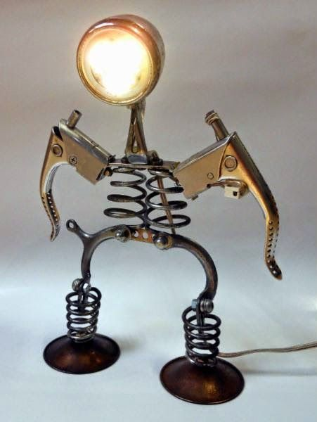i love lamps and lamps made from bicycle parts are so cool they are