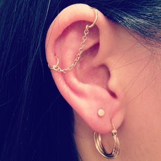 New Life Given To Old Industrial Piercing With Two Hoops And Thin