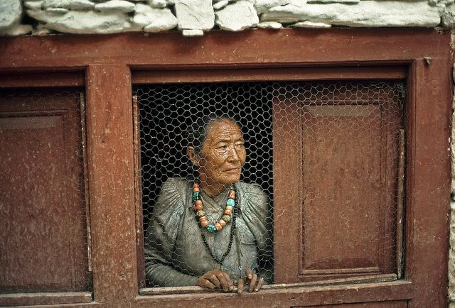 A woman at her window in a Nepalese village (1981). Nepal. UN Photo/John Isaac.