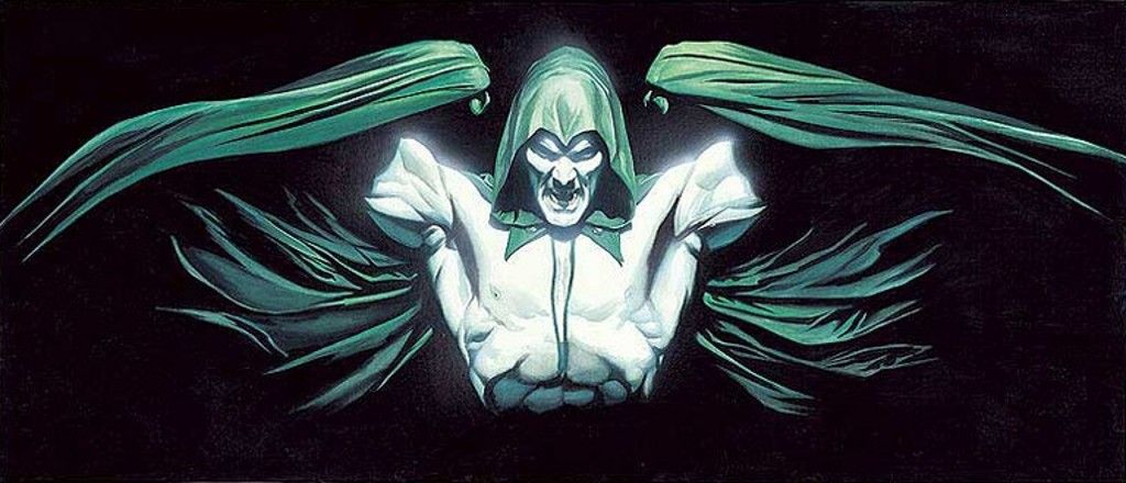 The Spectre stands with his arms wrapped into his cape.