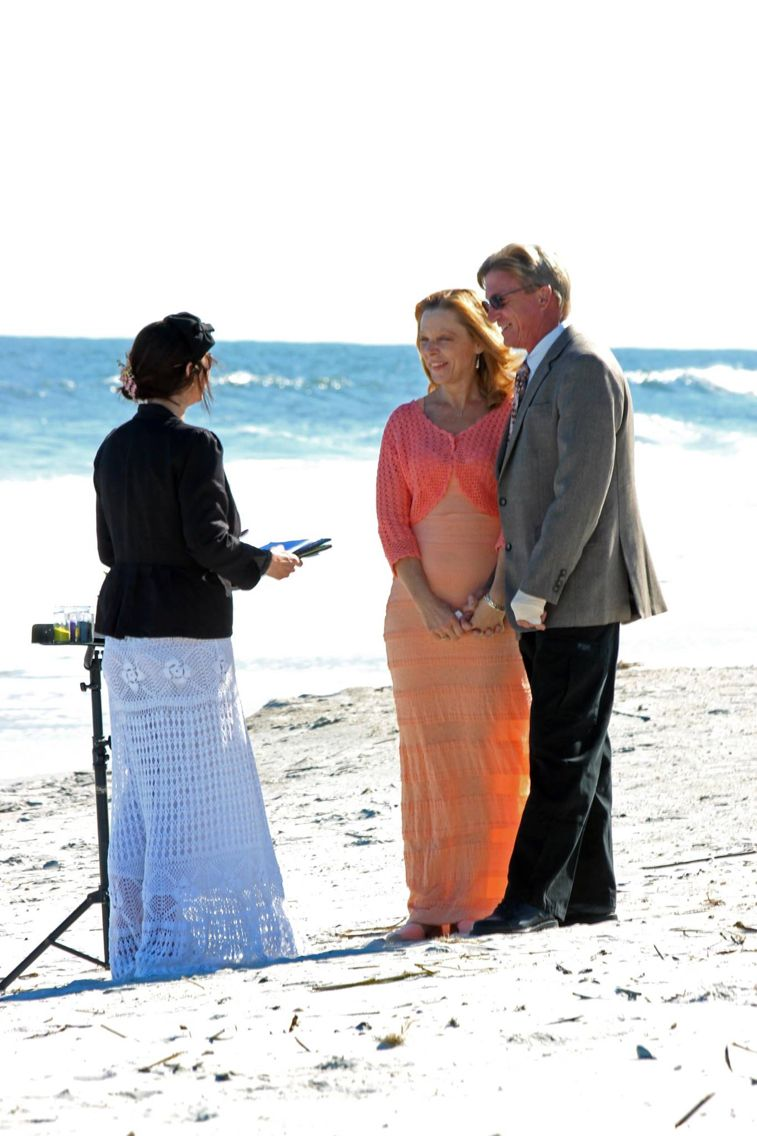 Jacksonville beach weddings  Incredibly sweet couple sealing the deal on Jacksonville Beach