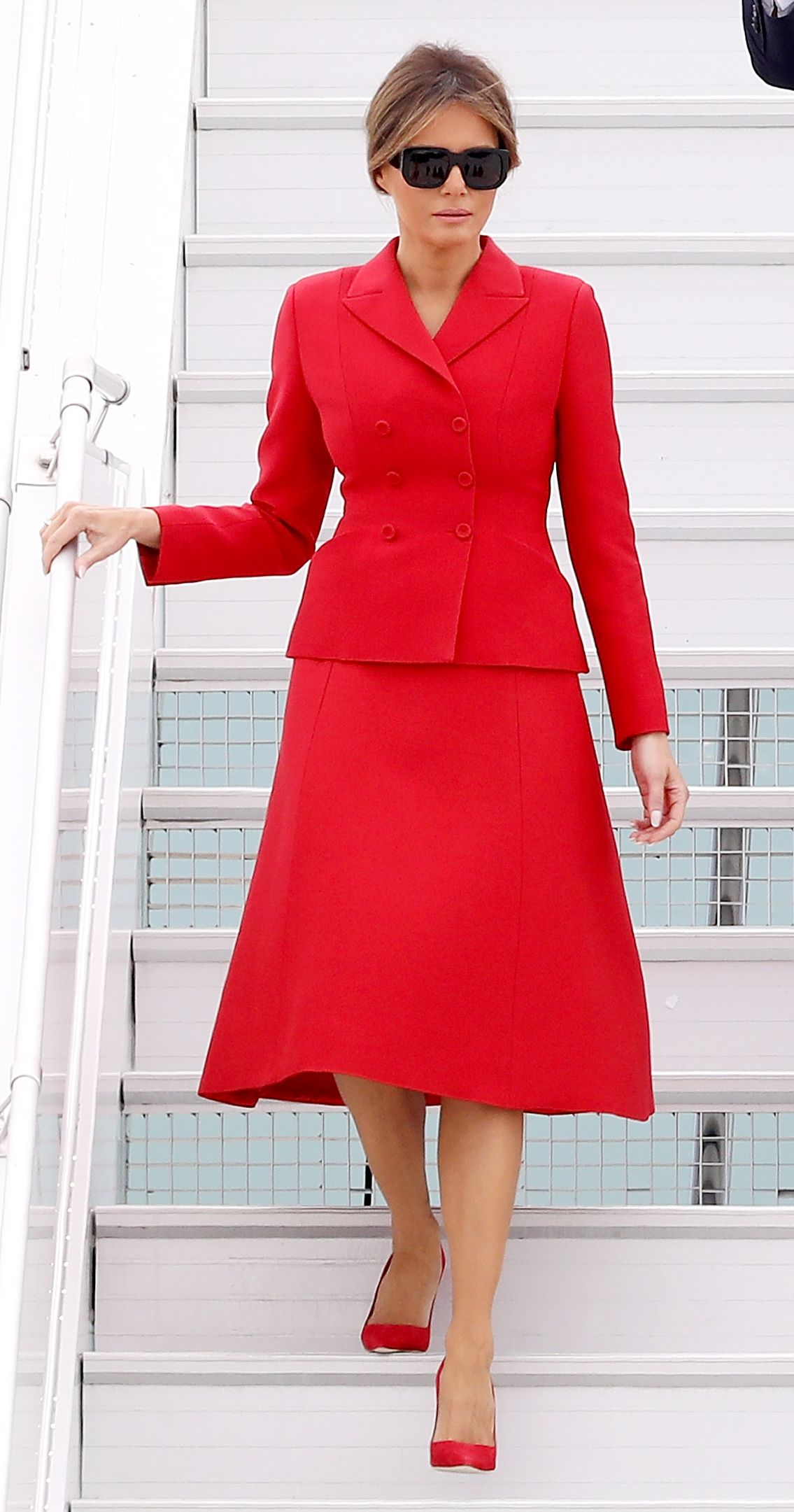 Melania Trump Wears Red Dior Skirt Suit To Touch Down In France Melania Trump Dress Trump Fashion Milania Trump Style