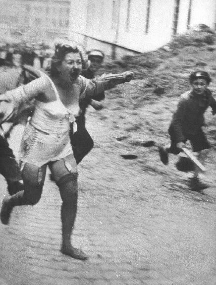 Lviv pogrom, July 1941. A terrified, wounded Jewish woman is running for her life pursued by Ukrainian mob. The day was marked by untold barbarities dealt upon the Jewish population.