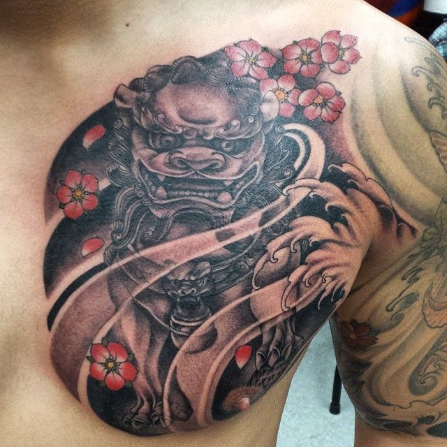 Black and grey chinese foo dog fu dog chest plate tattoo for Japanese style chest tattoos