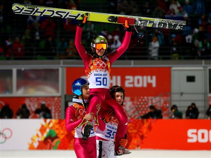 DAY 9:  Gold medlaist Kamil Stoch of Poland is lifted on the shoulders of Maciej Kot of Poland and Jan Ziobro of Poland after the Men's Large Hill Individual Final Round