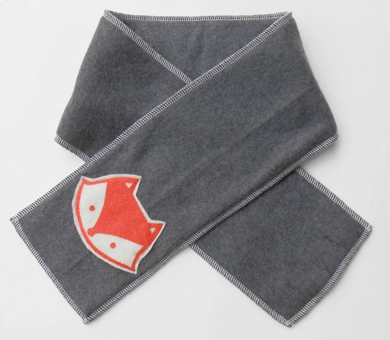 cute fleece kid scarf with silk screen embroider with the hole to put the other end through so you kid never lose them again...  Dimensions:  width - 5