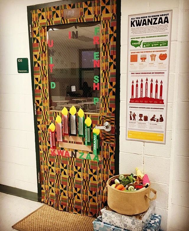 Our Kwanzaa door decoration including a straw mat and basket of fruit representi…