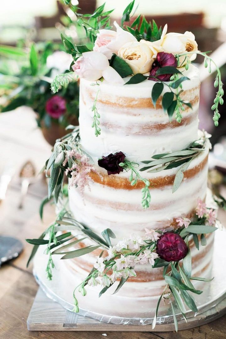 Beautiful semi naked wedding cake topped with flowers #nakedcake #nakedweddingcake #nakedweddingcakes #ranunculus