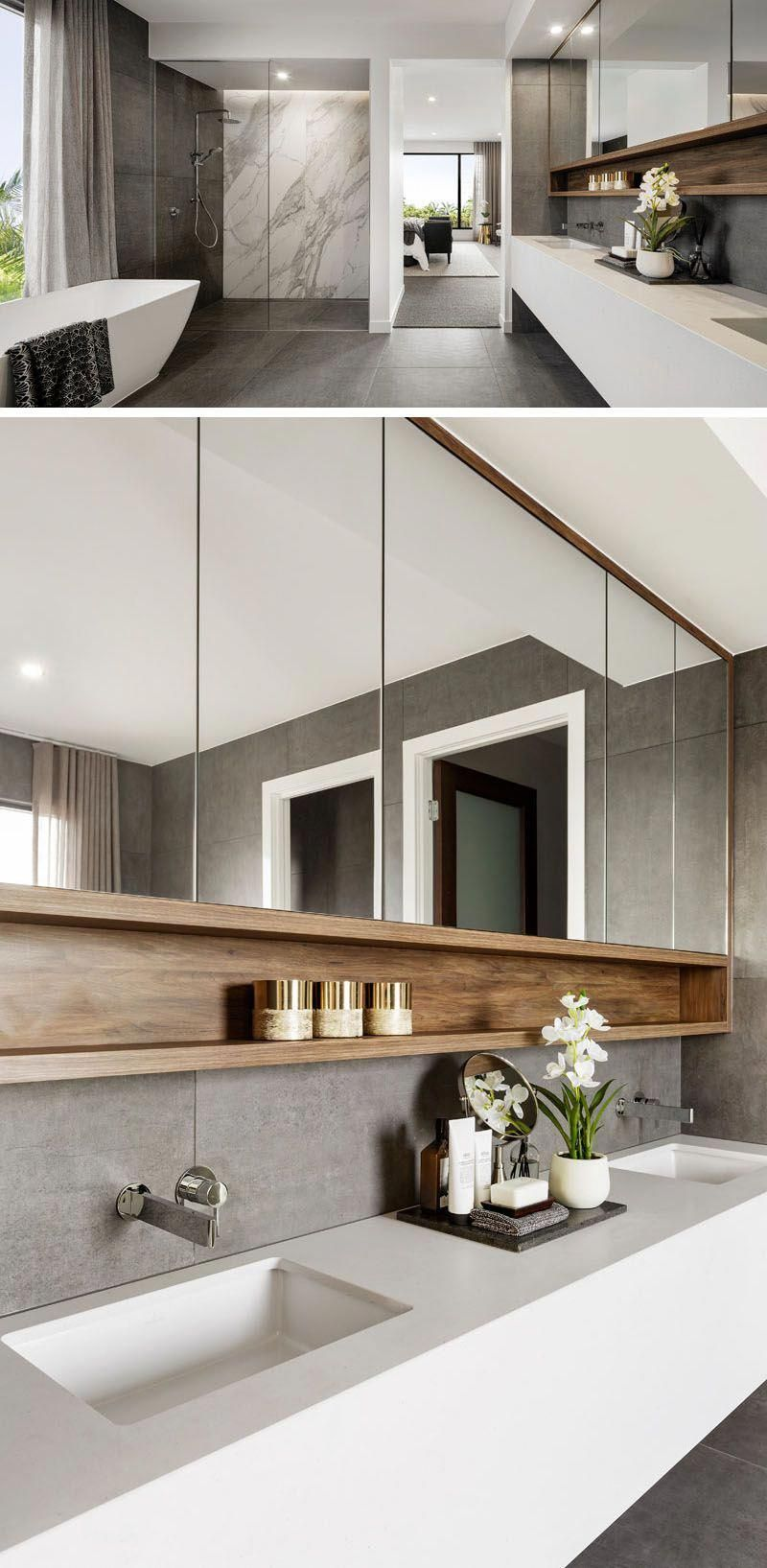 This modern ensuite bathroom features a large walk-in shower, a