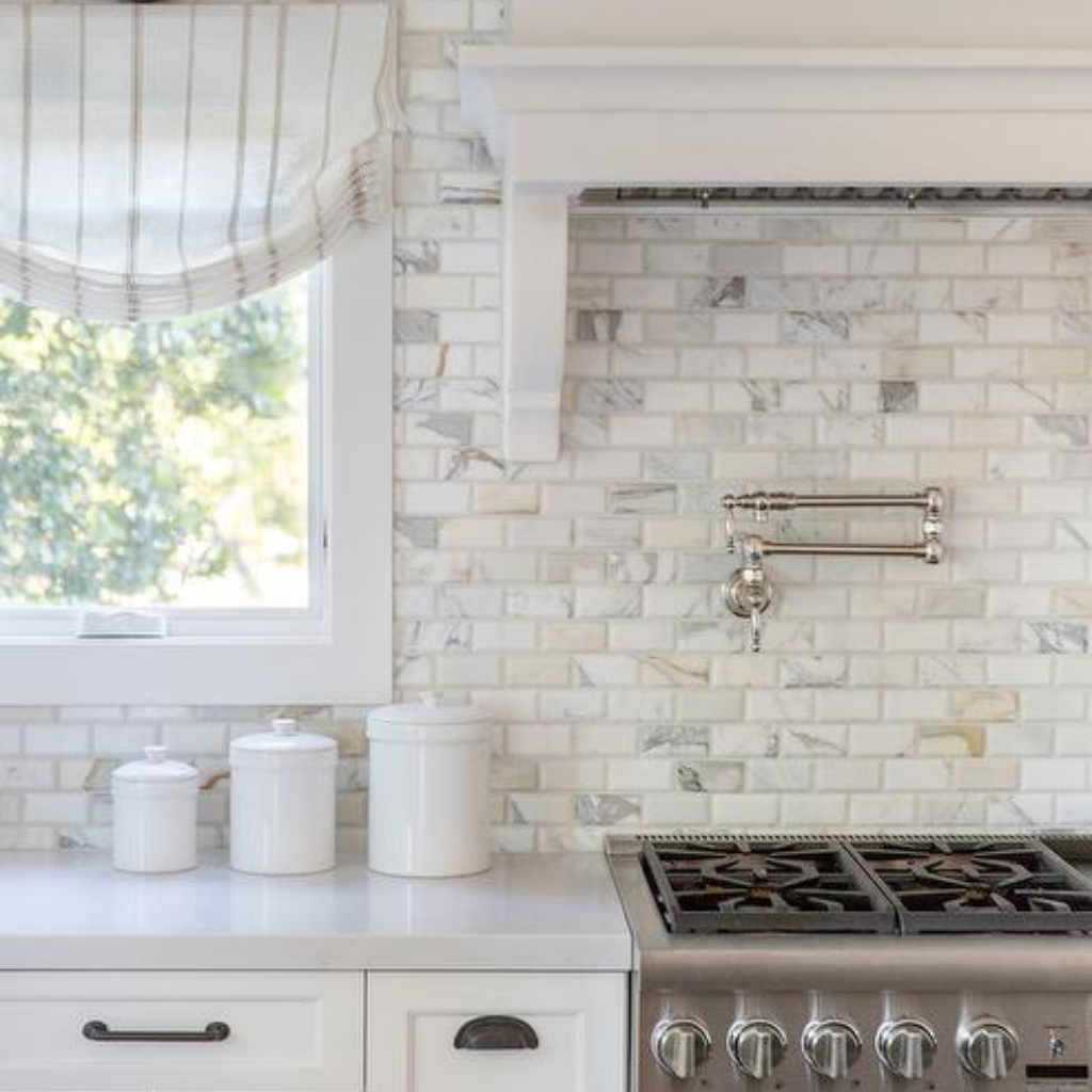 Calcutta Gold Marble Beveled Brick Backsplash Tiles In A