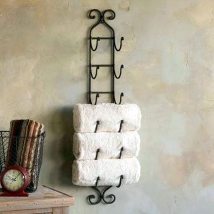 Bathroom towel storage on pinterest towel holder for Bathroom towel storage