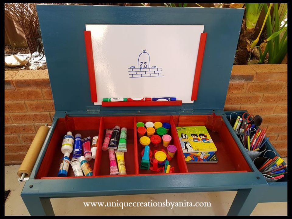 How to make a kids craft table is part of DIY Kids Crafts Wood -  activity table  A great idea to store all their craft supplies in one place when not being used