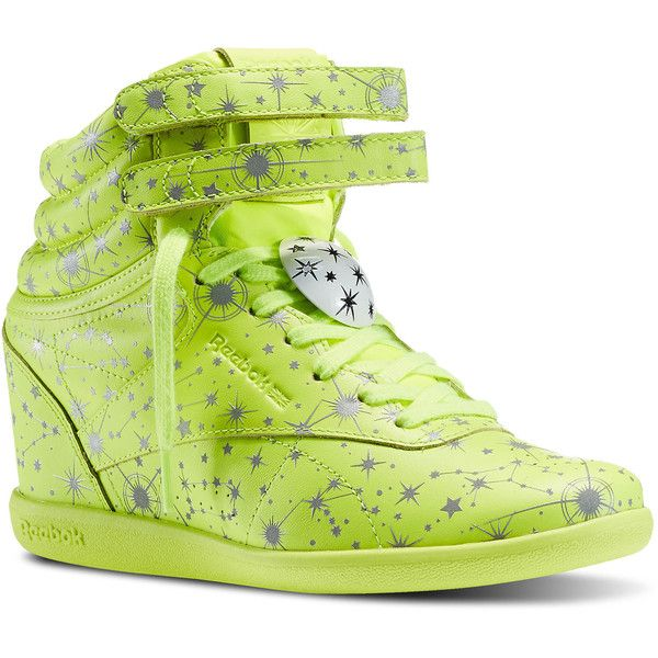 79c9e608f0ad LA designer Melody Ehsani takes another Reebok Classic to new heights with  this wedge cut Freestyle Hi. The reflective zodiac print symbolizes the  wearer s ...