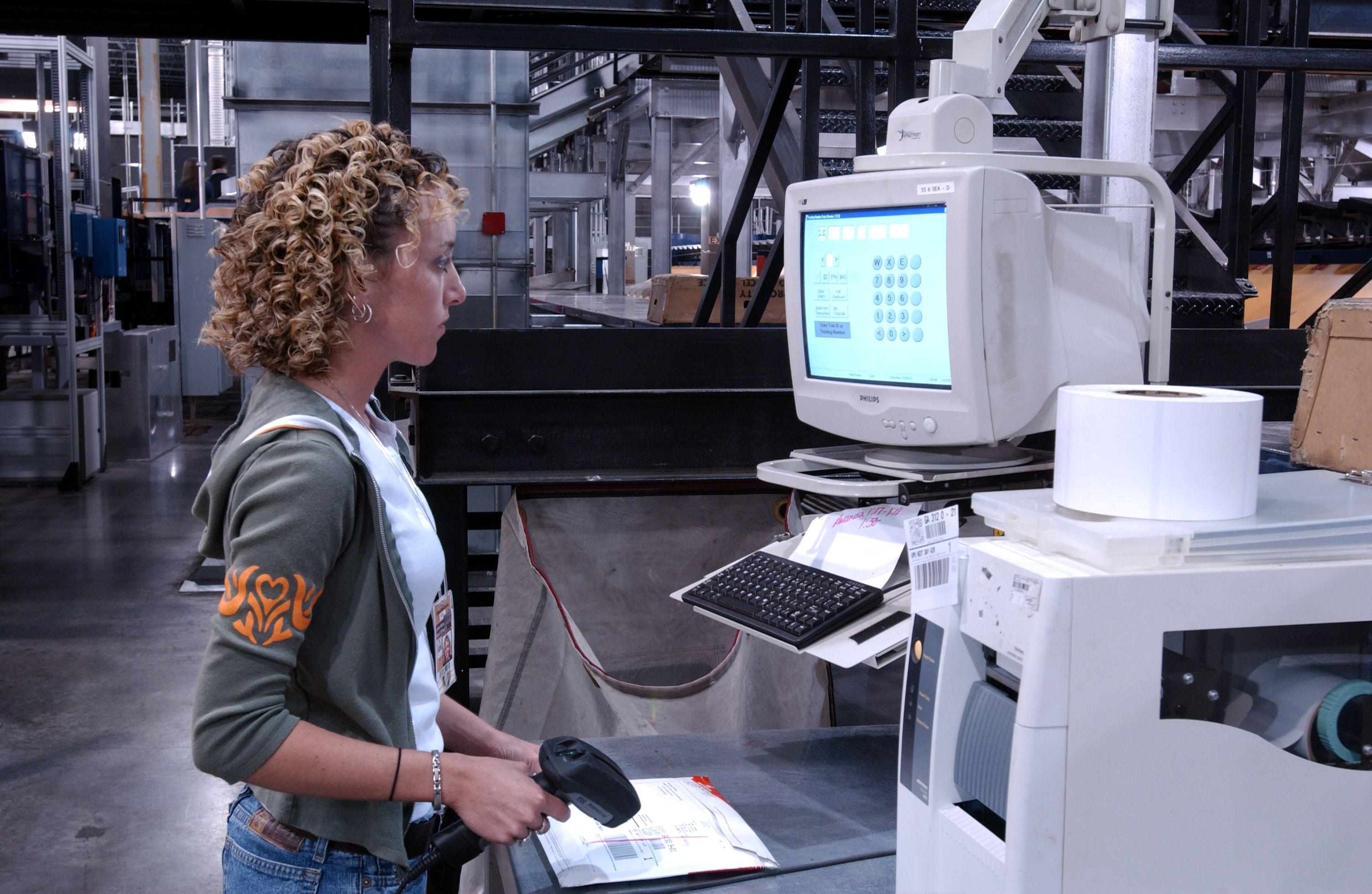 Employee working at UPS Worldport computer station