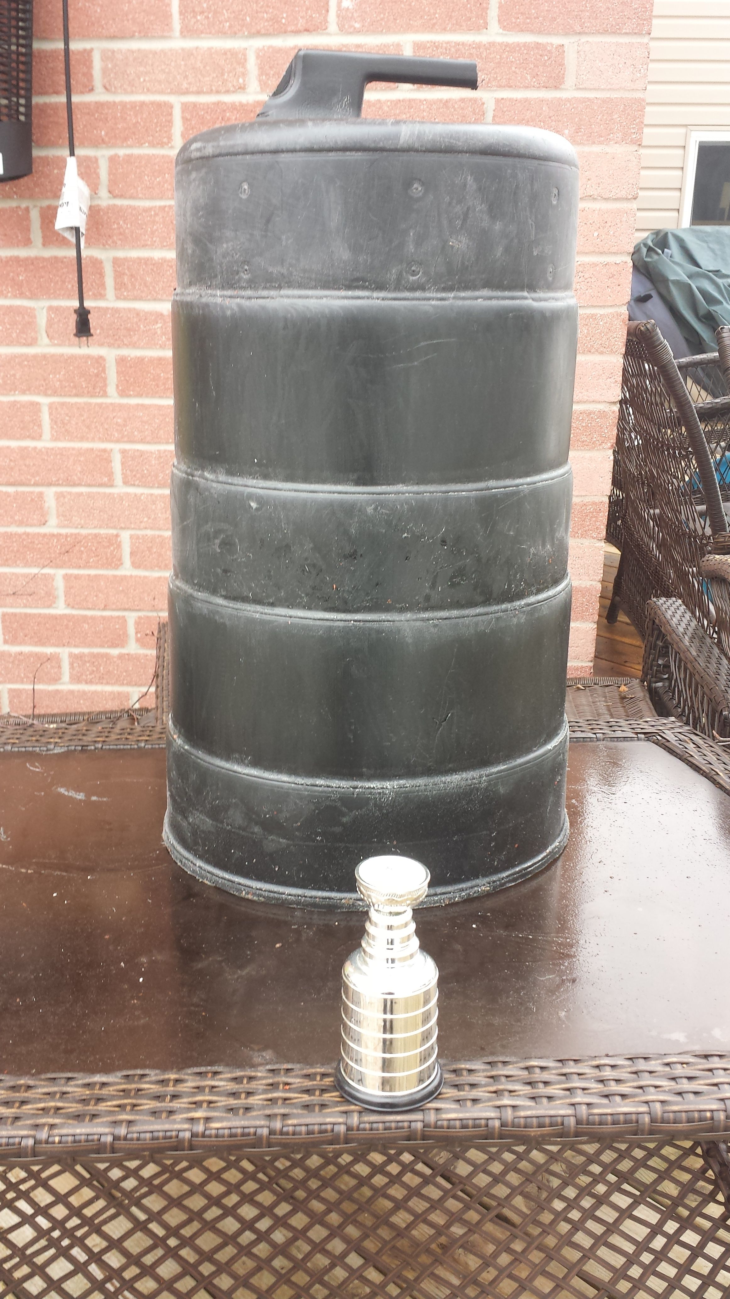 1. in the beginning a traffic cone with 5 tiers and the stickers removed and the handle cut down to allow the next tier to fit on top properly.
