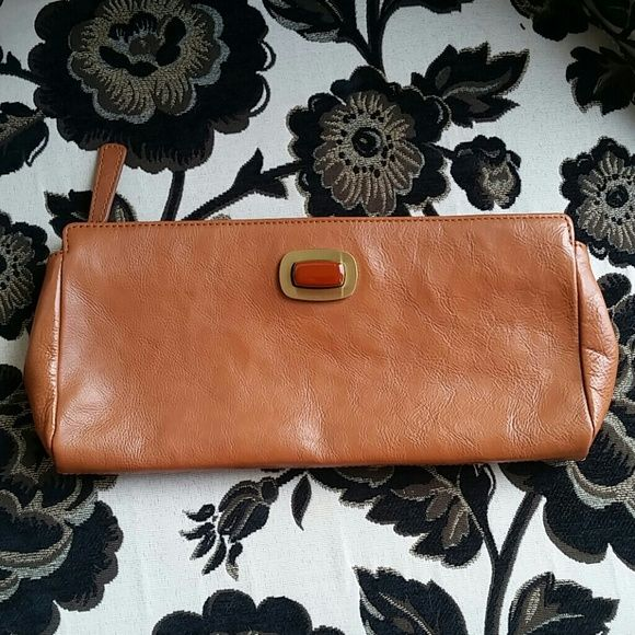 Cute leather clutch by Hobo Great tan leather clutch. Goes with everything.  A little wear (see pic) hobo Bags