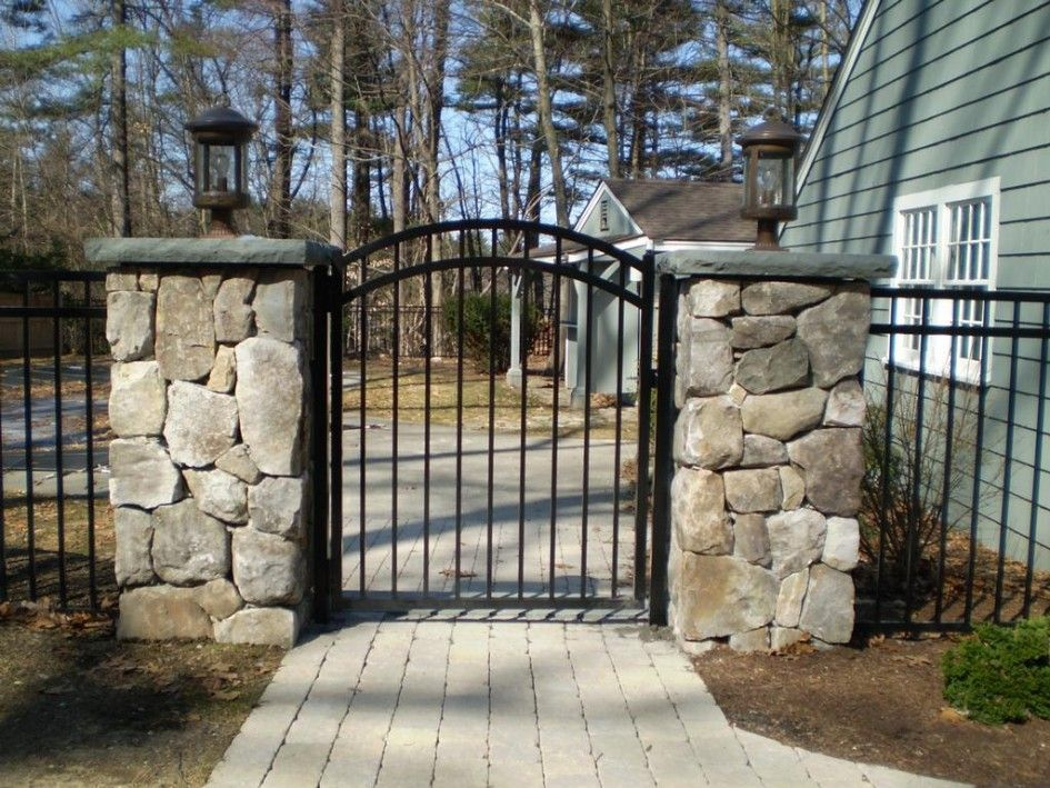 Elegant Stone Column Lights Using A Pair Of Wrought Iron Outdoor Lanterns With Energy Efficient Led Bulbs Fence Gate Design Iron Fence Gate Wrought Iron Fences