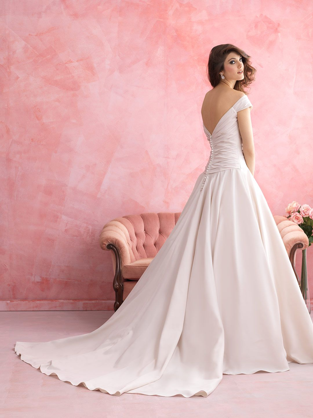 This satin ballgown achieves a deeply romantic effect with its off ...