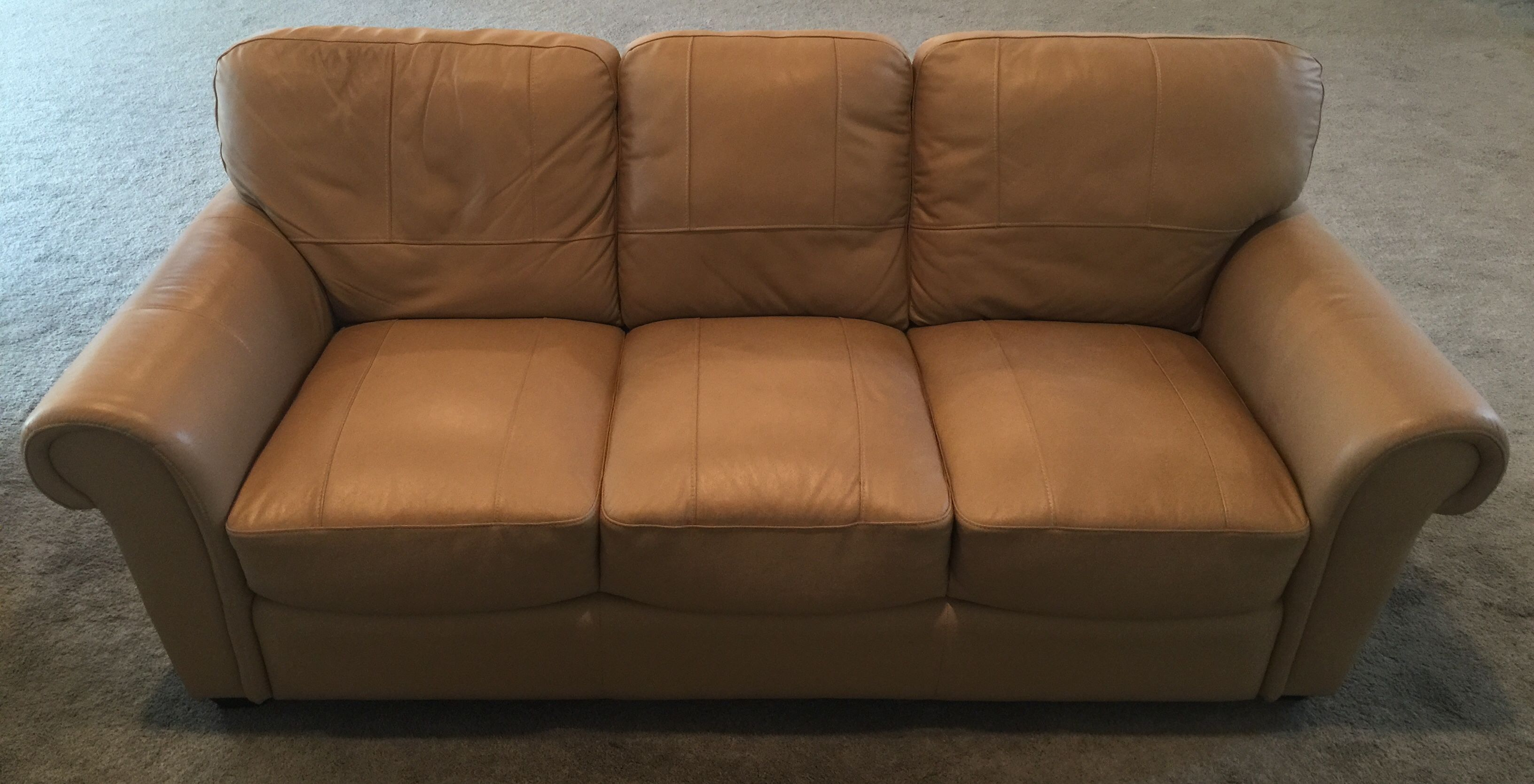 - SANDY COLORED LEATHER SOFA FROM JEROME'S. 36H X 84W X 34D