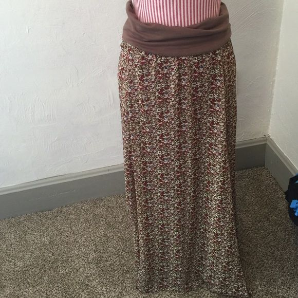 Multi-way lined maxi skirt or strapless dress Versatile skirt or dress. New without tags. Outer shell is sheer and light. Shell is 100% polyester. Lining is 100% rayon. Trim is polyester, rayon and 5% spandex. Pretty print. Kind of a medium small floral pattern. Colors are mainly burgundy with a forest green, brown, off white, blue and tan. Monroe & Main Skirts Maxi