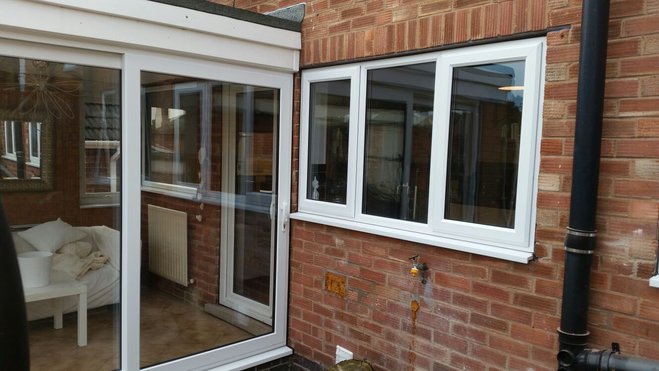 Synseal A Rated Double Glazed Sliding Patio Door And Windows In White Installed In Mapperley Nottingham For A Fre Sliding Patio Doors Windows Window Company