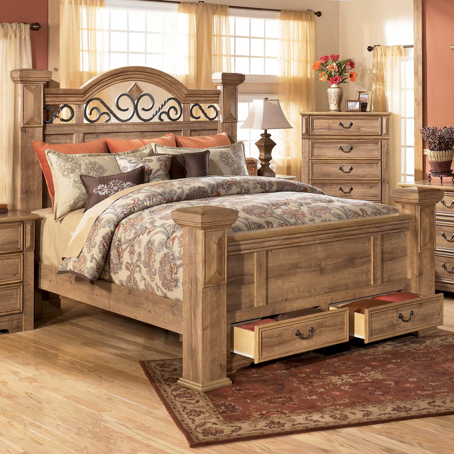 Whimbrel forge king poster storage bed by signature design for Bedroom furniture designs pictures in pakistan